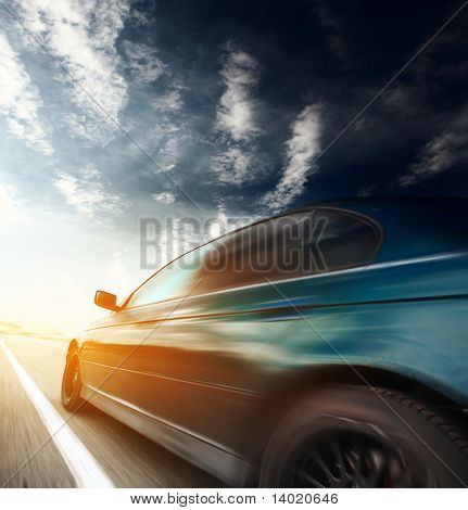 Motion blurred car on asphalt road