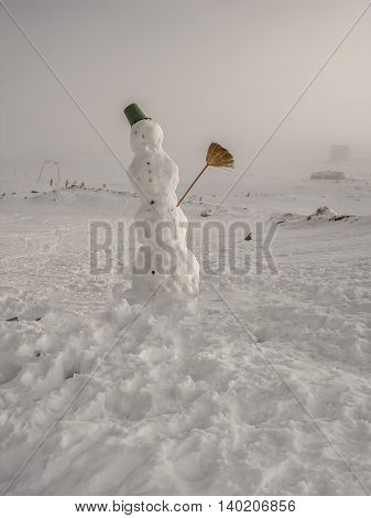 Funny Snowman In The Forest Standing In Winter Landscape