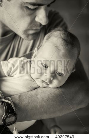 Latin American Father Holding Newborn Baby Boy In His Arms Monochrome Shoot