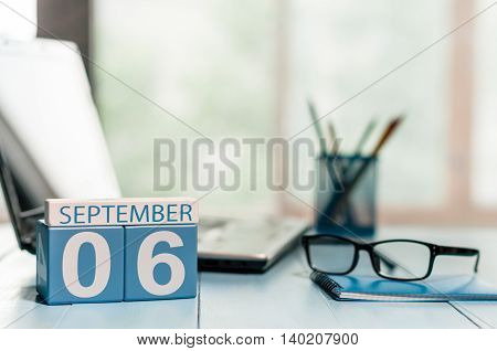 September 6th. Day 6 of month, wooden color calendar on CEO workplace background. Autumn time.