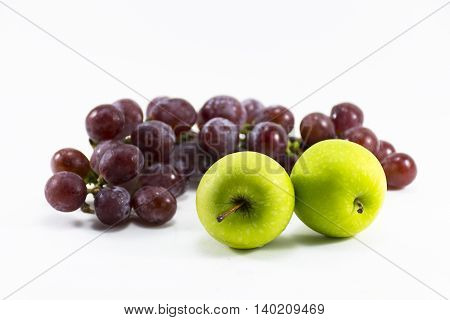 Red grape and green apple isolated on white background.Fruit for health and Hi-vitamin and Nourishing blood system.