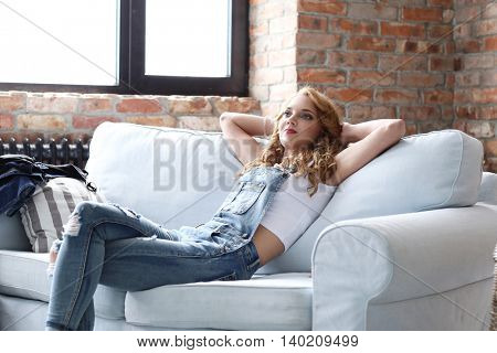 Lifestyle. Lovely woman at home