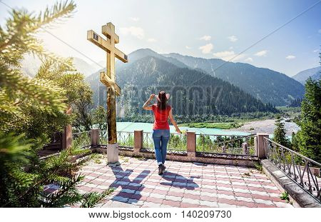 Tourist Woman At The Mountains Near Golden Cross