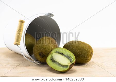 Kiwi in  white tank on wood and white background.Fruit for health and Hi-vitamin or food for health.6