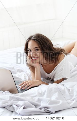 Lifestyle, home. Cute girl in the bed