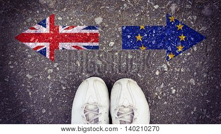 Flags of the United Kingdom and the European Union on street background