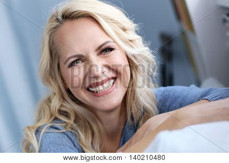 Beautiful woman with blond hair at home
