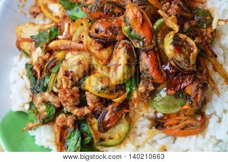 spicy stir-fried mussel and dolly fish with finger root on rice
