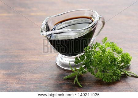 balsamic vinegar in a glass gravy boat