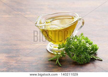 olive oil  in a glass gravy boat