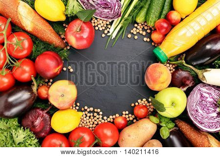 Frame of colorful fruits vegetables pasta and orange juice on dark surface. Frame of colorful fruits and vegetables background top view.