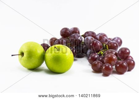 Red grape and green apple isolated on white background.Fruit for health and Hi-vitamin and Nourishing blood system.1