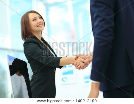 Business woman shaking hands closing a deal