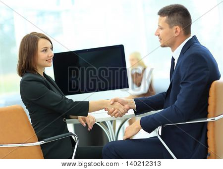 Business handshake.  people shaking hands, finishing up