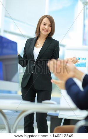 Successful  Woman making a business presentation to  group