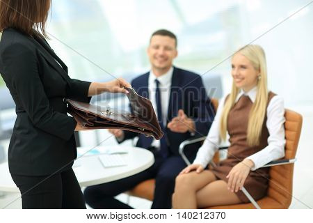 Business woman holding a briefcase