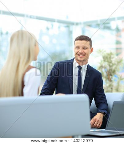 Business discussion in modern office