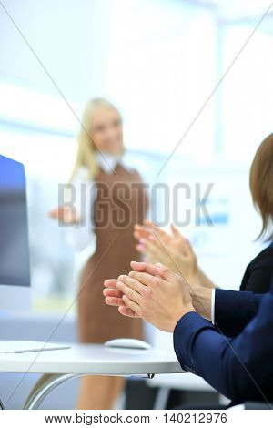 Successful businesswoman at the office leading a group