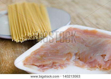 preparing italian wholemeal spaghetti with smoked salmon