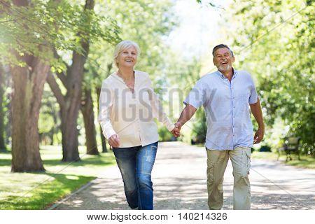 Senior couple running