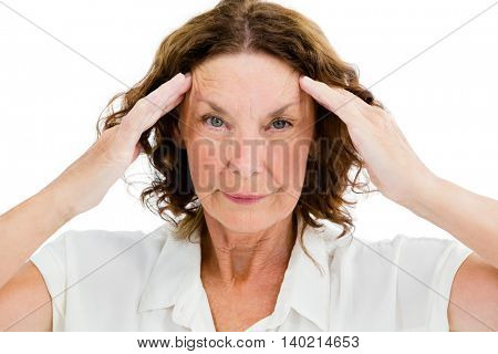 Portrait of unhappy mature woman having headache while standing on white background
