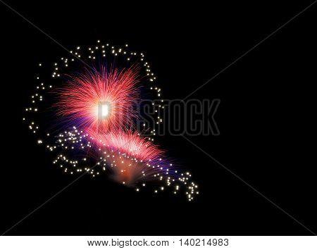 Colorful fireworks explode, red orange violet fireworks background. Light art. Visual art. Orange red fireworks background, fireworks festival, Independence day, Bastilian day, June 4, freedom