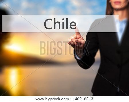 Chile - Businesswoman Pressing Modern  Buttons On A Virtual Screen