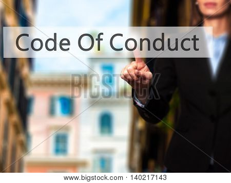 Code Of Conduct - Businesswoman Pressing Modern  Buttons On A Virtual Screen