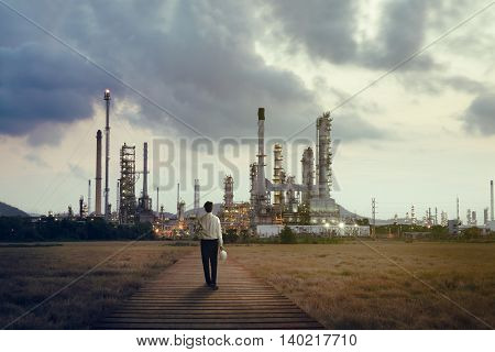 Engineer standing at Oil refinery Power and energy crisis concept