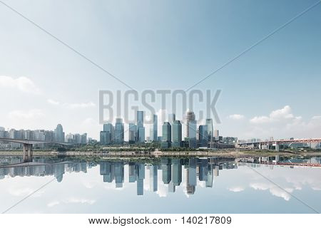 landscape of downtown near water of chongqing in blue sky
