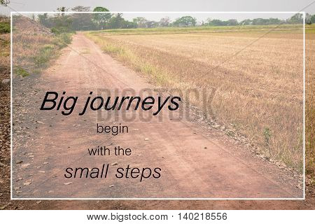 Word  Big Journeys Begin With The Small Steps.inspirational Motivational Quote On A Countryside Road