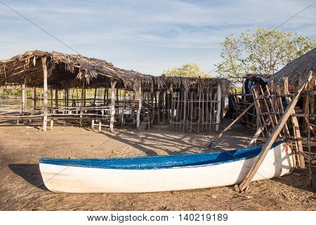 rustic white boat on land from Nicaragua