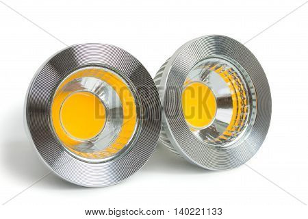 Pair of energy saving LED light-emitting diode bulbs with socket type GU10 isolated on a white background close up.