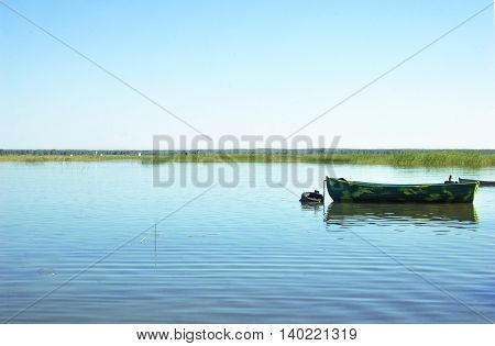 Lonely boat on the lake, summer evening, Russia