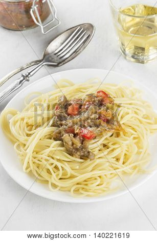 Spaghetti With Eggplants And Various Vegetables On A White Background