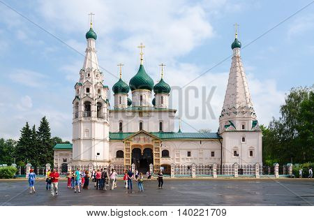 YAROSLAVL RUSSIA - JULY 21 2016: Group of unknown tourists is on square near Church of Elijah Prophet in Yaroslavl Golden Ring of Russia. Church was built in 1647-1650 years and is monument of architecture