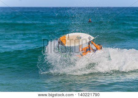 Sydney Australia - November 26 2014: Surfer falling into closing wave Bondi Beach in the Eastern Suburbs Sydney New South Wales Australia.