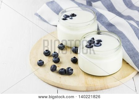 Yogurt With Blueberry On A White Background