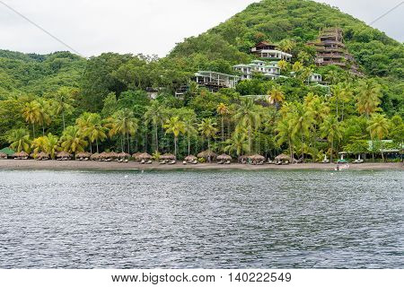 houses on a hillside on the shores of the ocean St Lucia Caribbean
