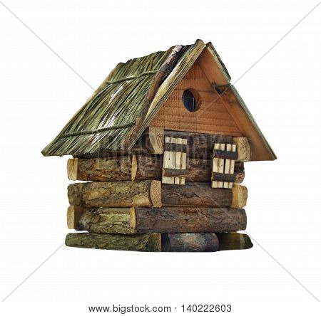 Model of simple village wooden log house isolated on white background. Toy decorative house made from rustic hardwood