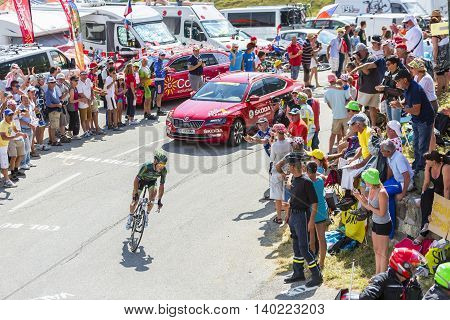Col du Glandon France - July 23 2015: The French cyclist Thomas Voeckler of Europcare Team riding in a beautiful curve at Col du Glandon in Alps during the stage 18 of Le Tour de France 2015.