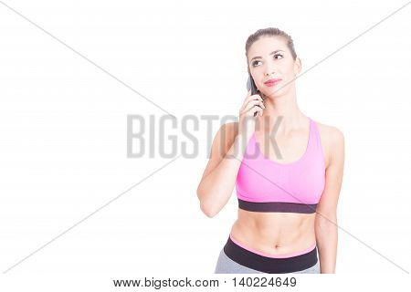 Fit Girl Speaking On Telephone And Looking Up
