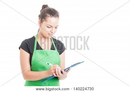 Attractive Female Seller At Work Holding Clipboard