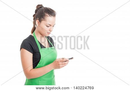 Attractive Young Seller Typing A Message On Cellphone