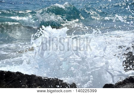 Ocean Wave Splashing The Rocky Coast