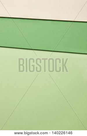 Colored cardboards background in green beige tone. Copy space. Horizontal