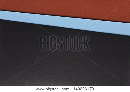 Colored cardboards background in brown blue black tone. Copy space. Horizontal