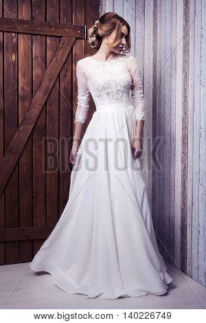 Portrait of the beautiful bride on wooden door background