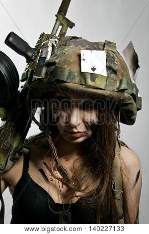 Pretty female soldier with ak-104 posing over white
