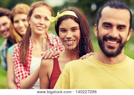 friendship, leisure, summer and people concept - group of smiling friends outdoors